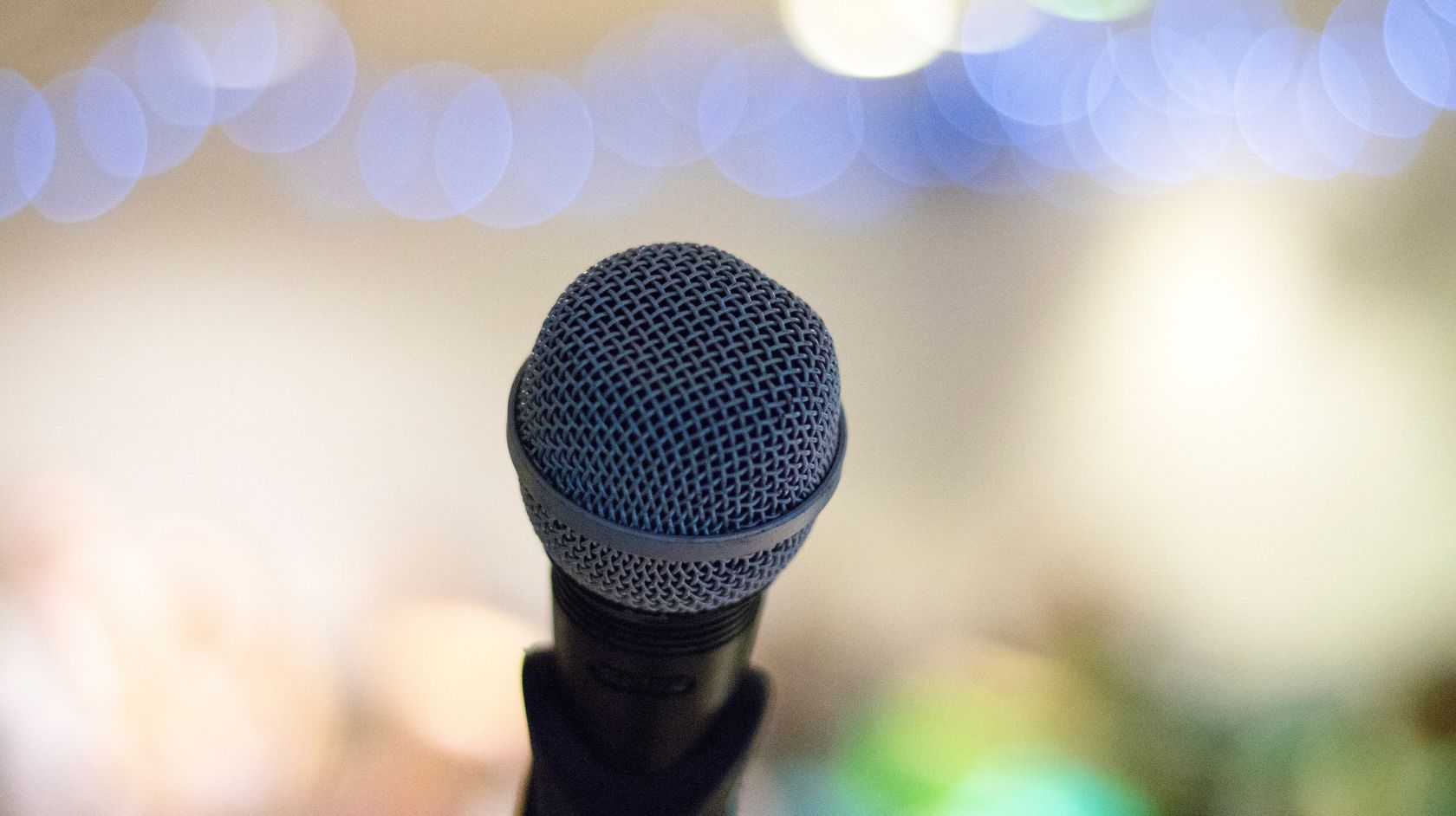 Microphone with fuzzy twinkling lights background